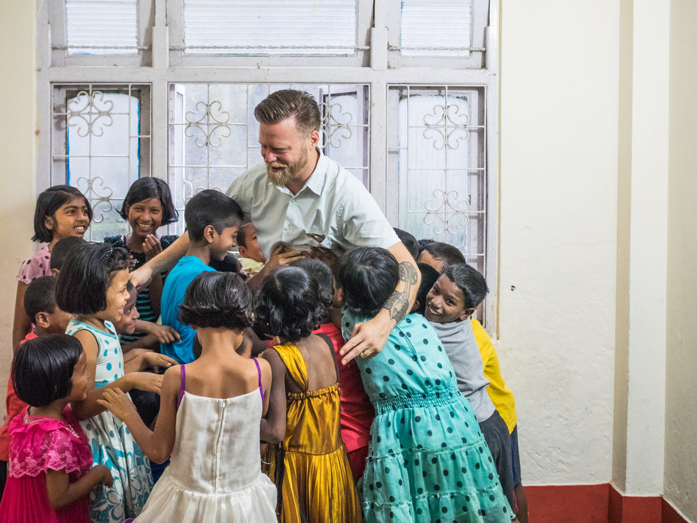 Executive Director John McCollum with children from Asia's Hope India