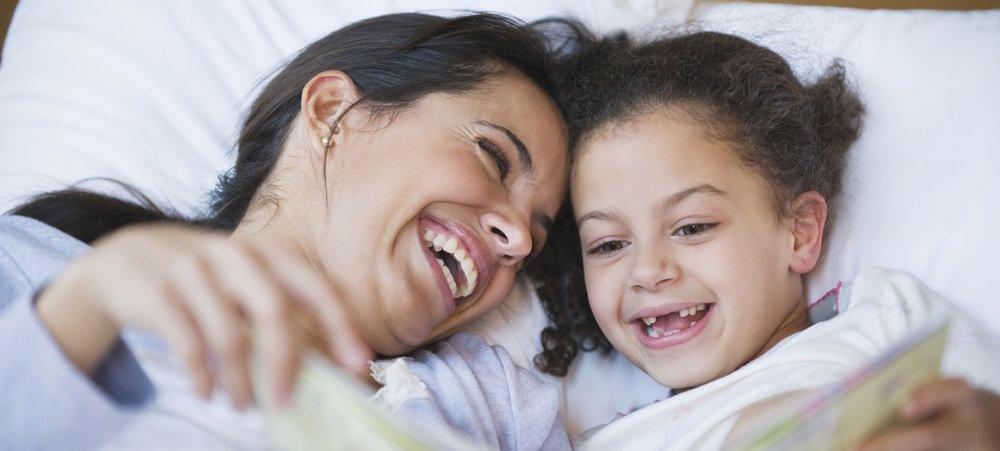 636072580435138582596132687_hispanic-mother-reading-book-to-daughter-1.jpg
