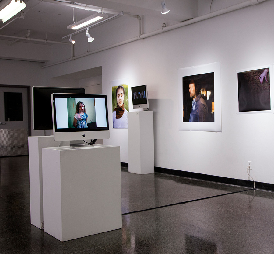 Installation shot from  Gender & The Lens   Monitor: Front monitor: WildFires: Women Photographers Network in Scotland, WHEN THE LIGHT SHIFTS  Background by Ava Cochrane (OCAD U) and Alia Youssef (Ryerson University)