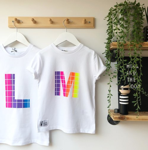 2fe041667 Grid print multi coloured personalised t-shirt in white with your choice of  letter and pick your own colours. With short sleeves