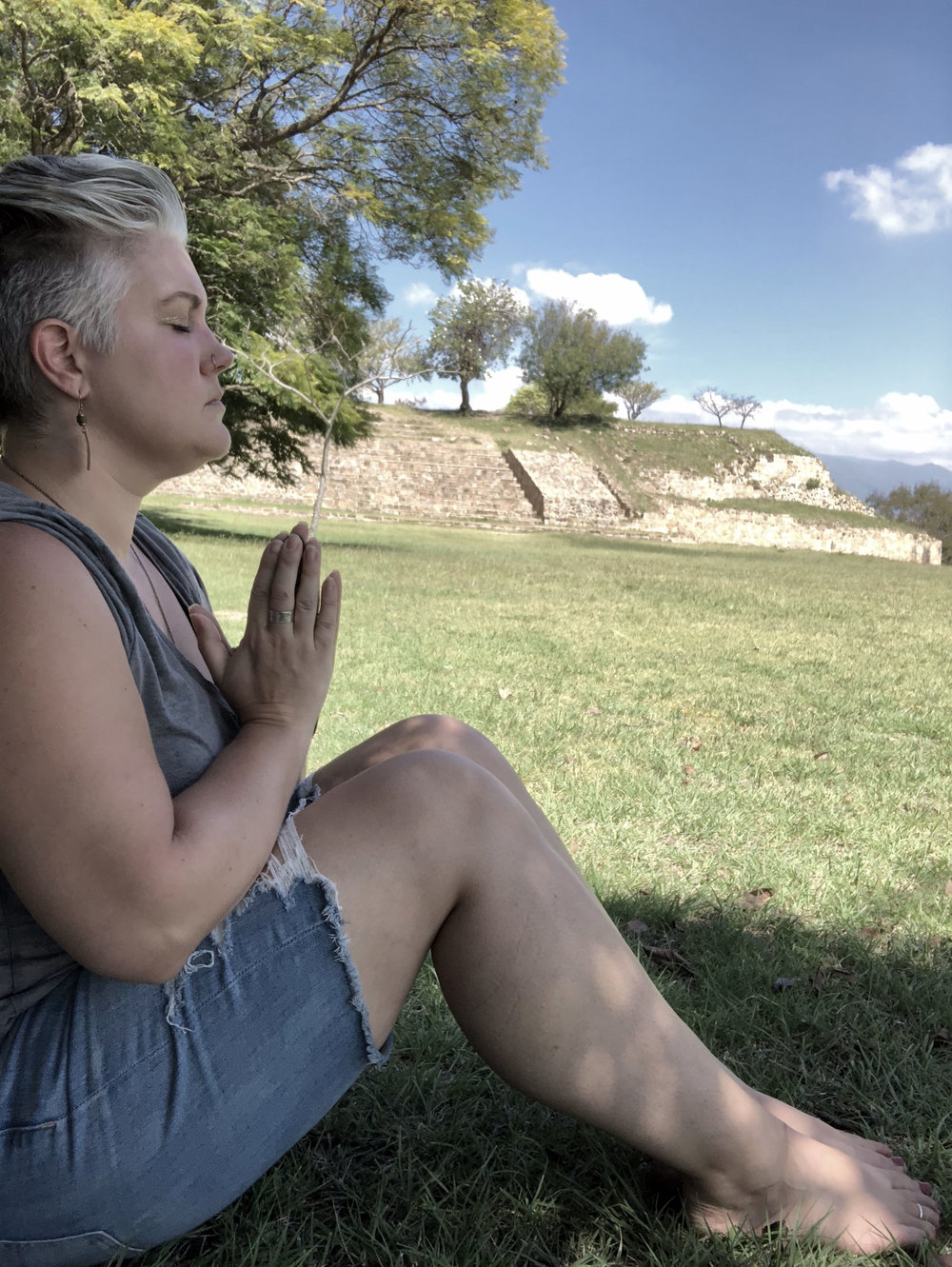Taking a moment to connect with the Earth at Monte Alban, Oaxaca City.