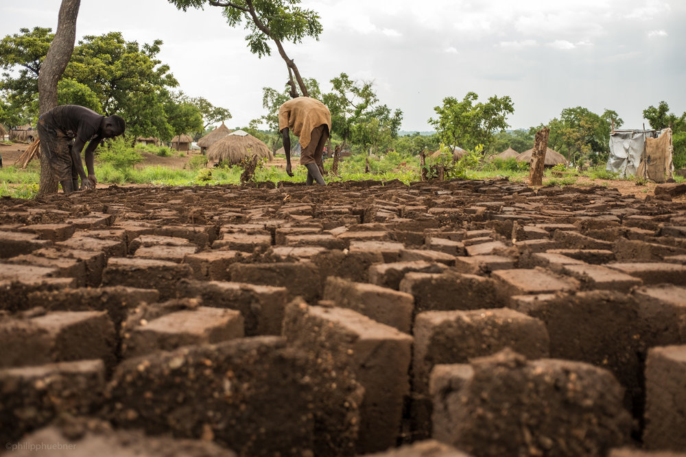 setting up mud bricks to dry