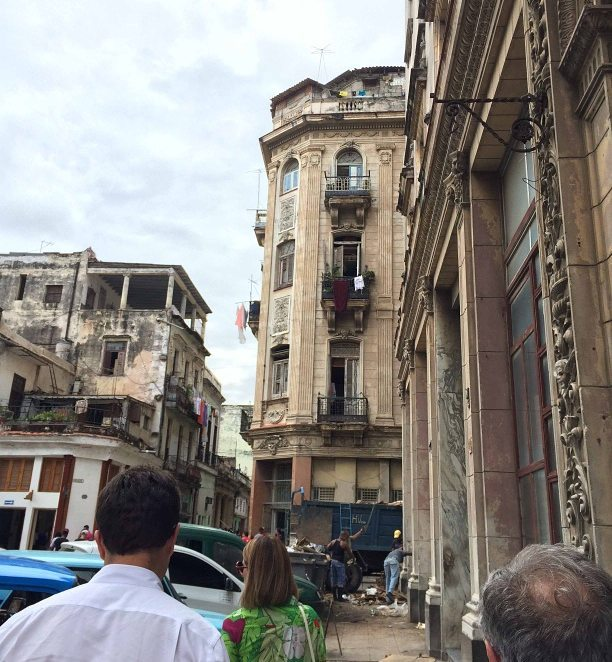 How fast the city changes...when this photo was taken a year ago, this was just a normal building. Now it's the site of one of Havana's best rooftop bars...but which one?  #havana #cuba #travel #nightlife #mysteries #bars