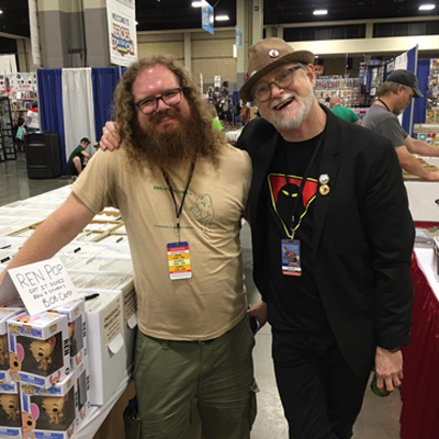 Adam with Ren & Stimpy co-creator Bob Camp, spotlighting our deal on Funko Pop Ren vinyl figures down at HeroesCon!