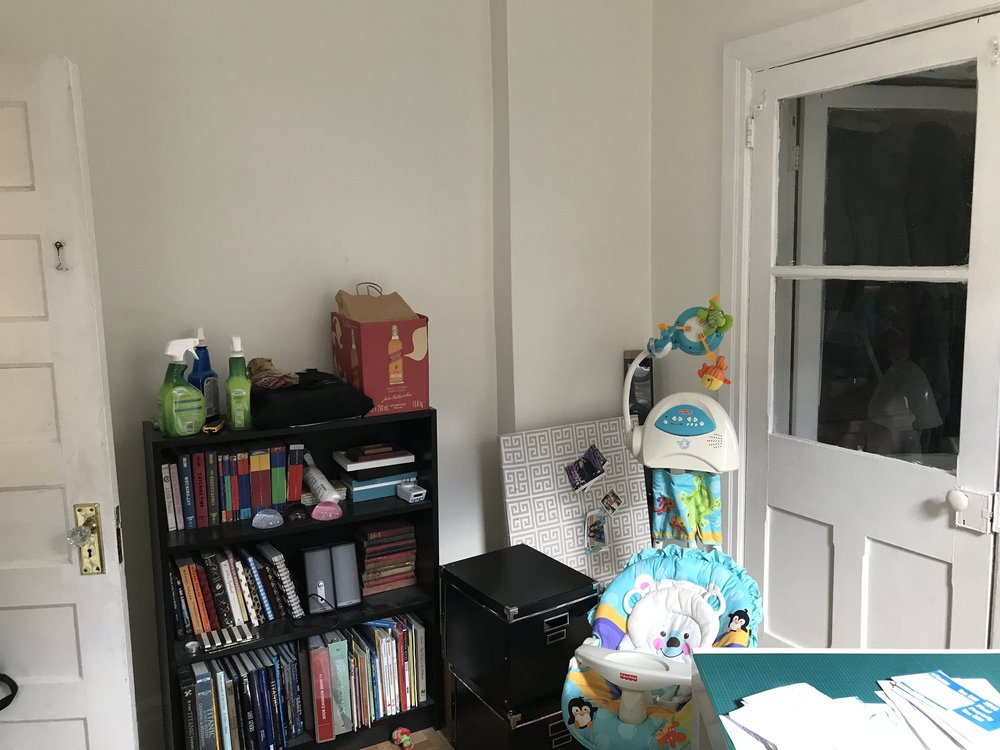 Entrance to the room is through the door at left (the other door leads to a storage room). Our focus lately has been on getting baby-ready, including setting up the nursery, so this room has become a bit of a dumping ground in the meantime.