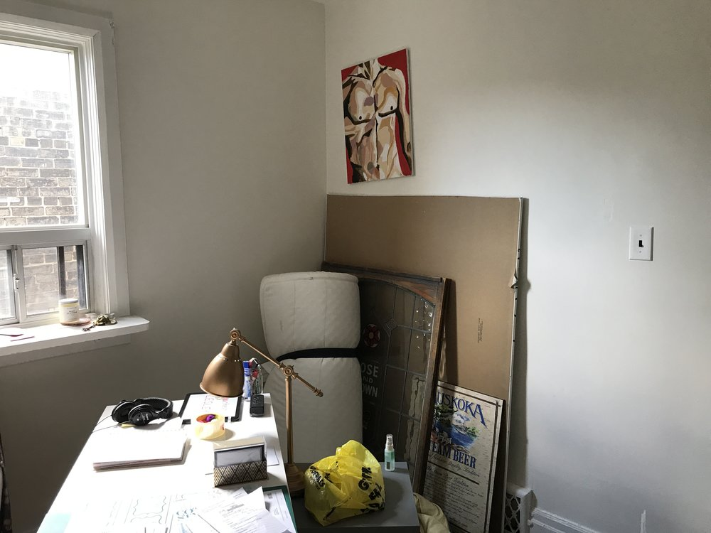 I had some major plumbing repair work done on my shower/tub fixtures a year ago and still haven't patched the holes in the wall after the pipes were fixed! There is a large hole behind that torso painting, and an even larger hole behind that piece of drywall leaning against the wall. Time to finally get this done!