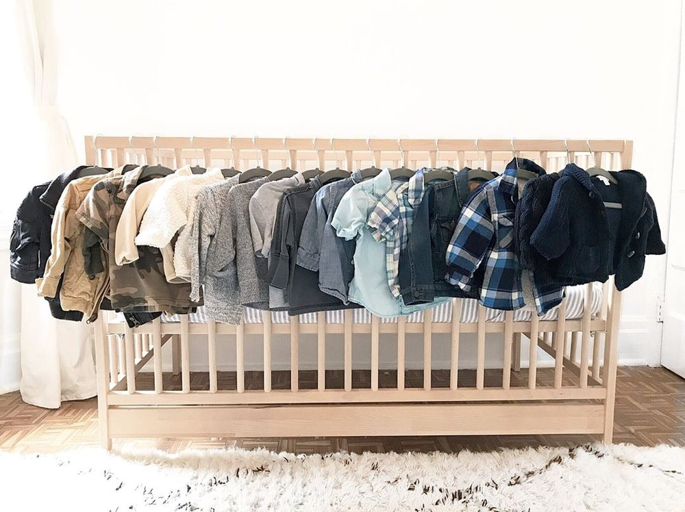 baby-clothes-hanging-on-crib.jpg