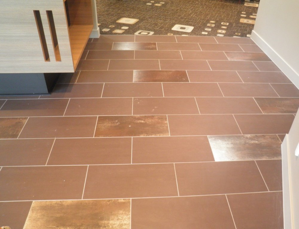 Coffee Matt and Copper Feature porcelian tiles to entry flooring 2.JPG