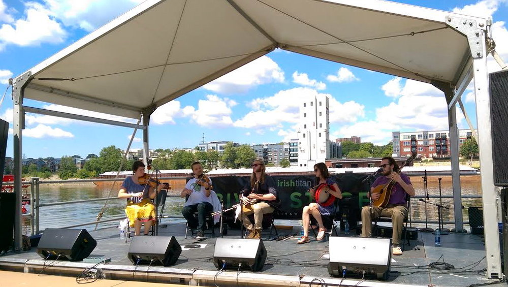 L to R: Rosa (fiddle), Keyreel Raskolenko (fiddle), Ryan Behnke (pipes), Cara Wildman (bodhran), Buddy Ferrari (vocals/bouzouki) on the River Stage at the Minnesota Irish Fair