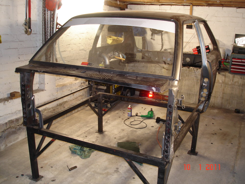 This shows the mods and what was left of the original Toyota Starlet shell.  I only kept what i needed and when bolted onto the chassis in six places managed to hold its own shape ok.