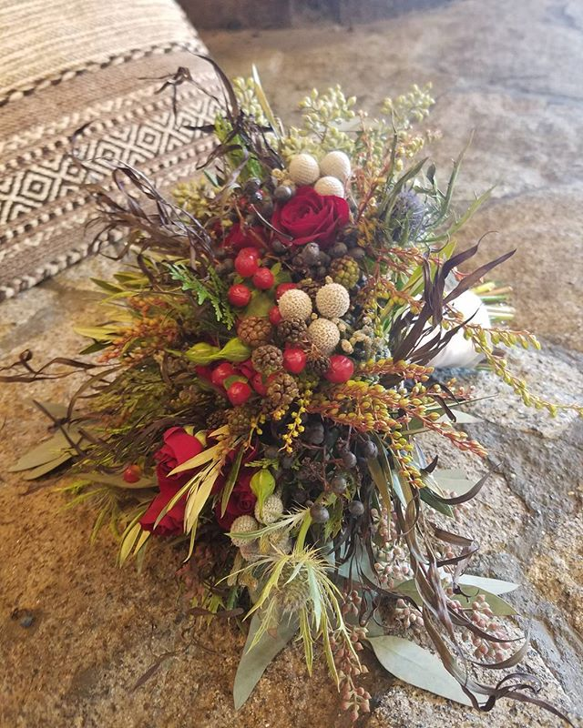 Winter inspired bridal bouquet. #bruniaberry #privetberry #seededeucalyptus #sprayroses #greenery #winterweddings #rusticvibes #tahoeflorist #tahoebride #Tahoewedding #squawwedding #rusticbouquet #bridalbouquet #handtiedbouquet #flowermagic #flowersoftheday #flowersofinstagram #loveandlupinesbride #mountainwedding #mountainbride