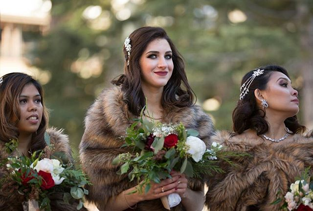 I am in love with these fur wraps that @themichelleoblea chose to keep her #bridesmaides warm for her #winterwedding. They look so lovely with their #bouquets. 📸by the talented @sashaphotosf