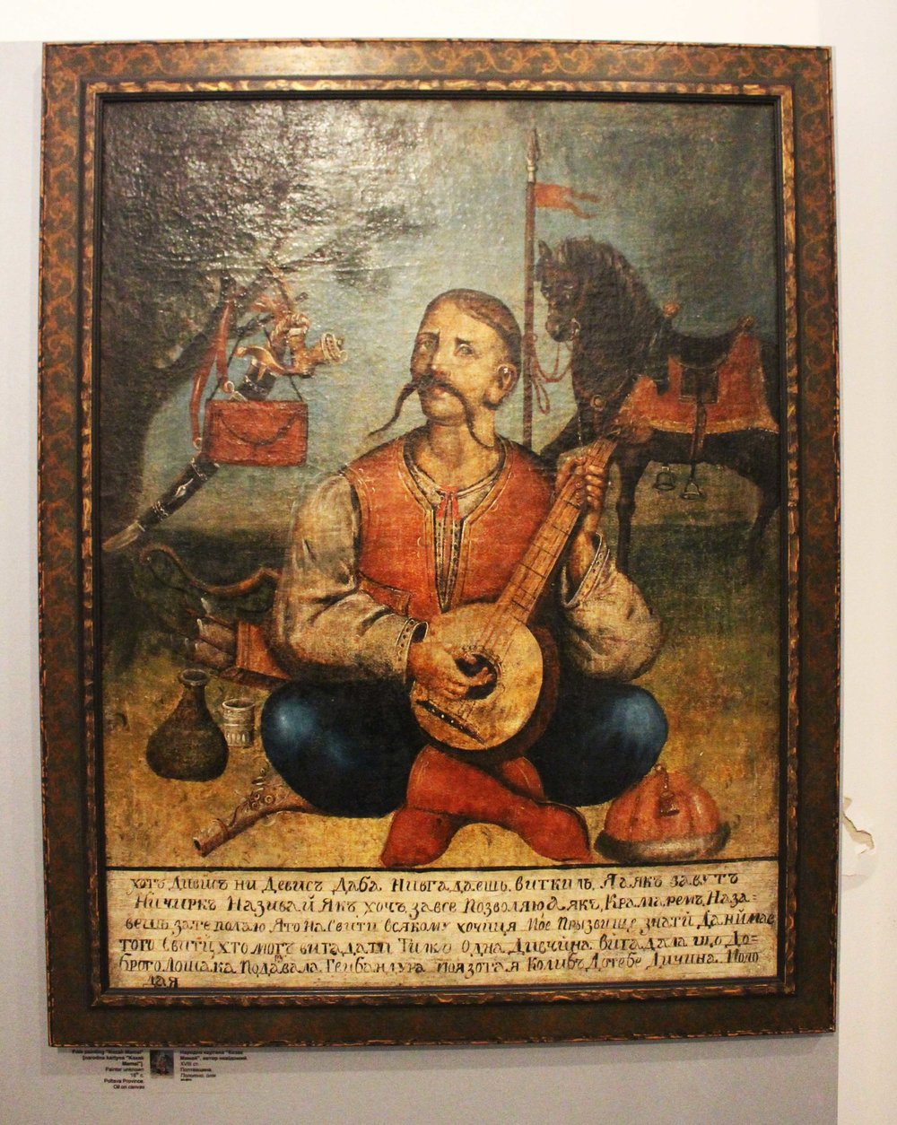 Many people have created similar paintings to this, featuring a Kozak sitting cross legged playing a bandura with a horse in the background. The various objects in the painting symbolize different things, but overall, our museum guide said this painting symbolizes the proud Kozak history. Ukrainians hang it in their home for protection.