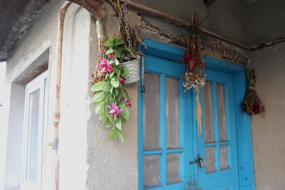The flowers above the door protect against evil spirits from entering the building.