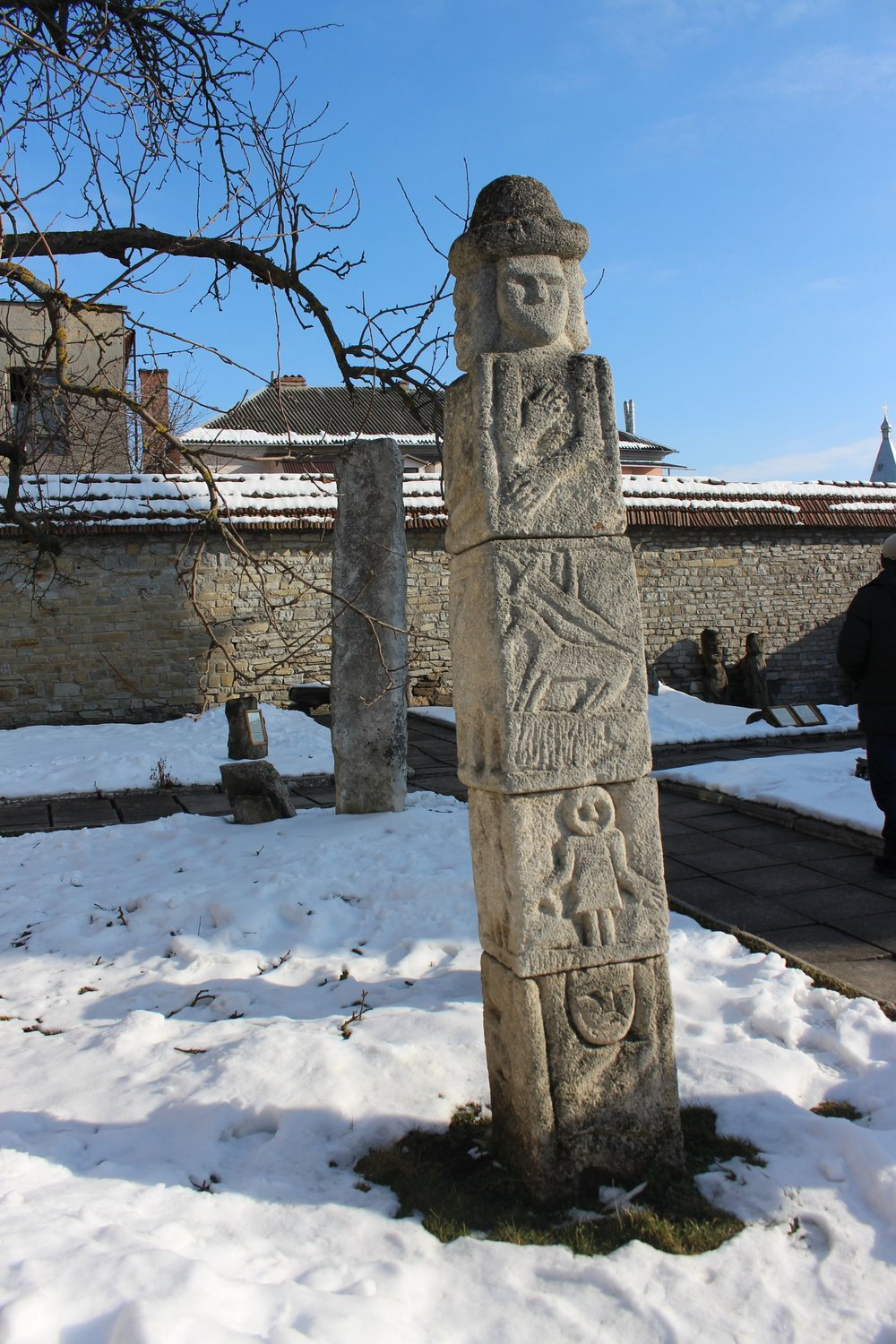 This replica of a sculpture tells a story, much like a totem pole.