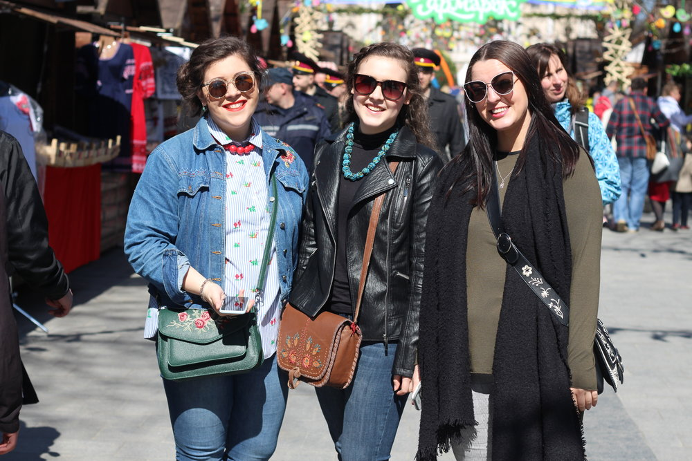 Hannah, Natalya, and Kaitlyn explore the Easter market.