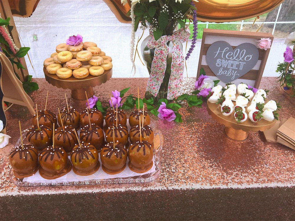homemade caramel apples, chocolate dipped strawberries, and lemon and vanilla glazed donuts