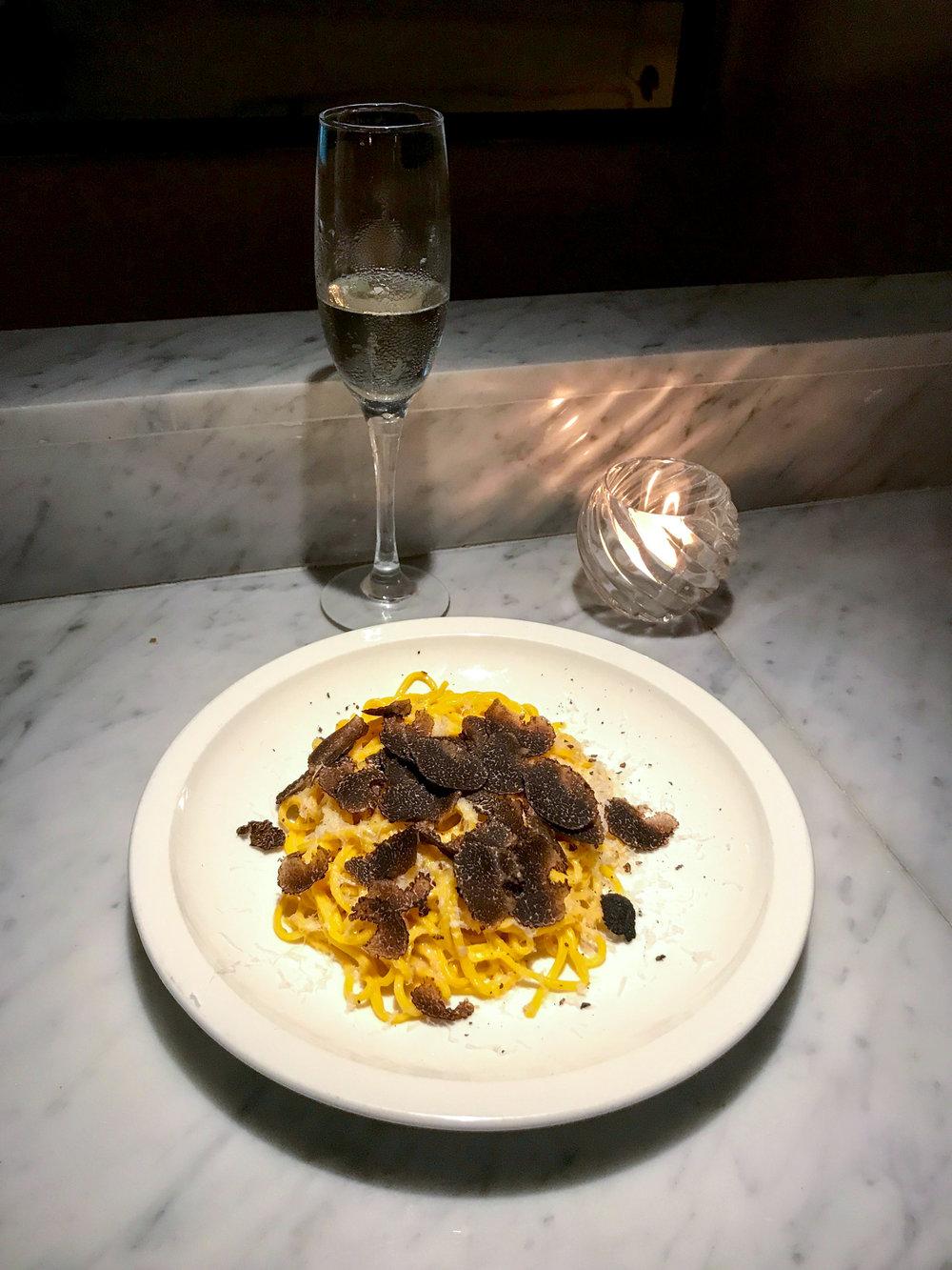 Tagliolini with shallot, white truffle paste, fresh shaved black truffle