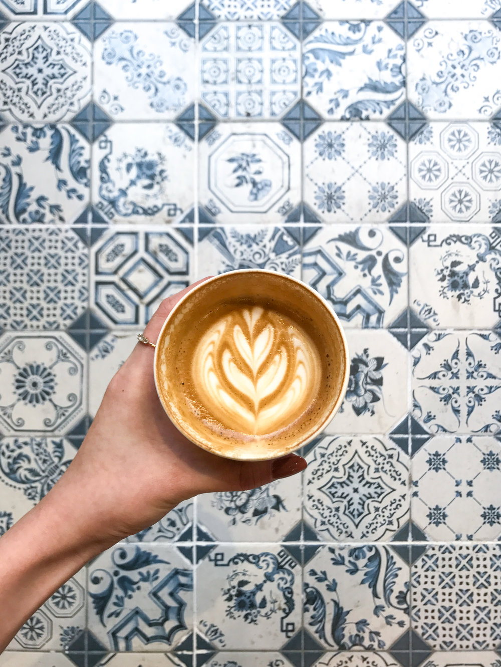 The patterned tiling at the entrance makes for the perfect coffee photo backdrop.