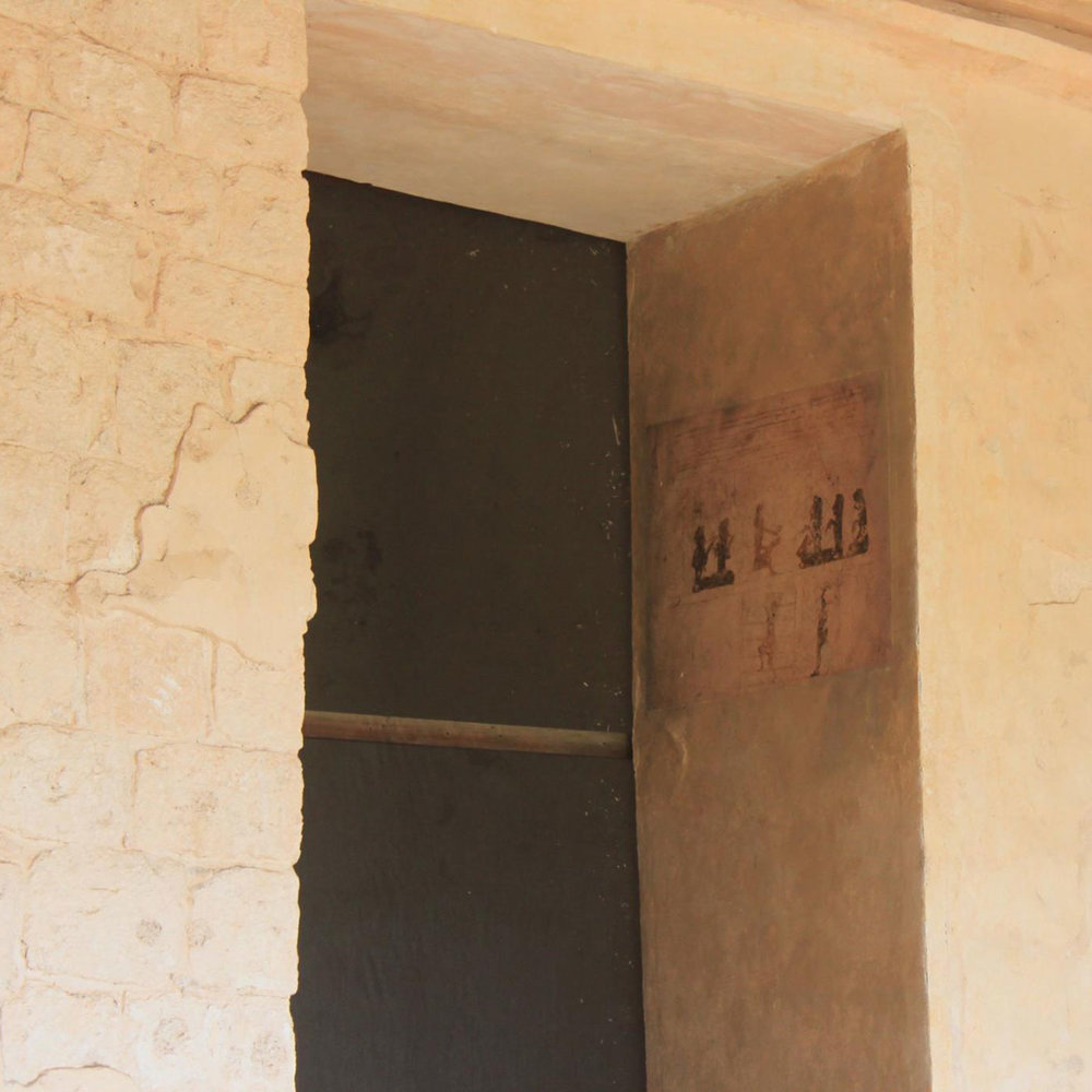 Note the drawing of the traders on the side of the door to the tomb entrance. The traders have different colour of skin. Are they from afar?