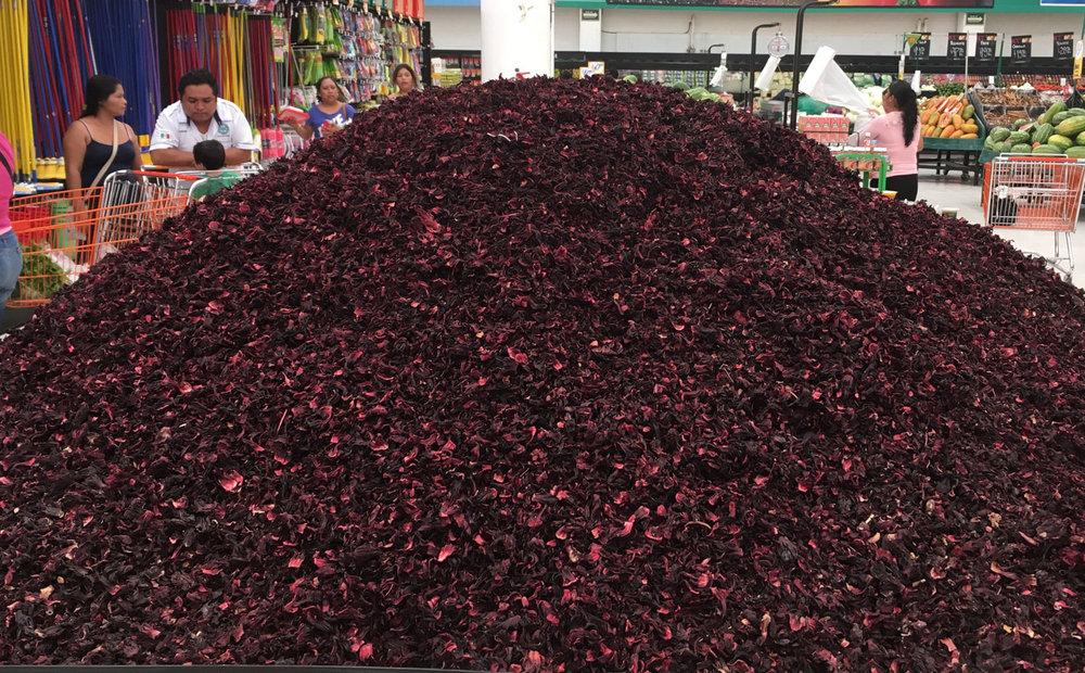Jamaica (hibiscus),popular plant for natural juice. Left: Dac shop.