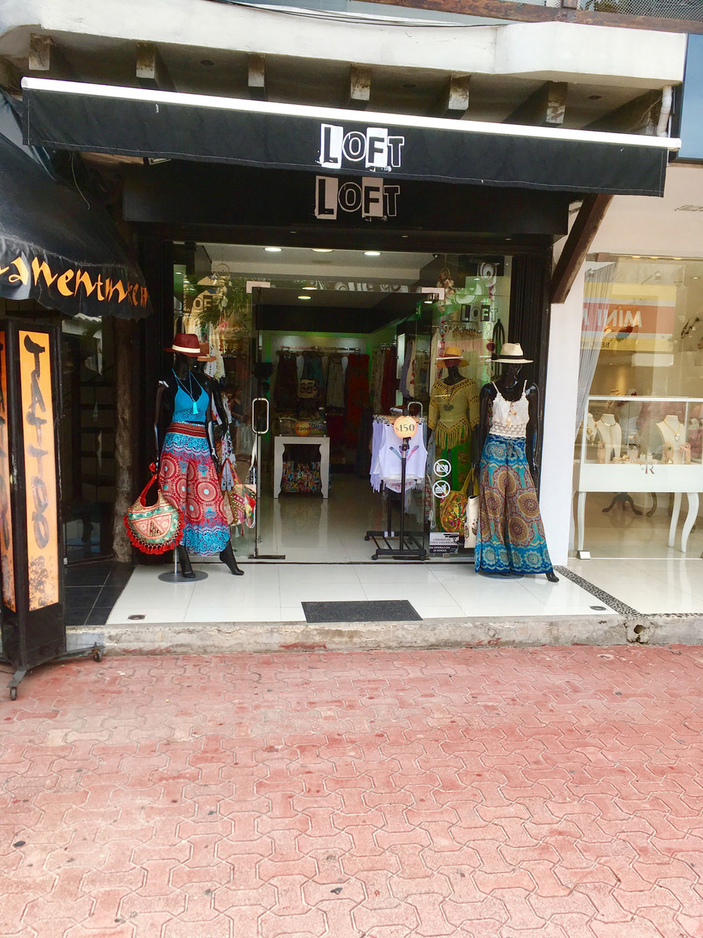 Fashion boutique shop on Fifth Avenue. Right: Catrinas outside the shop welcome the shoppers.