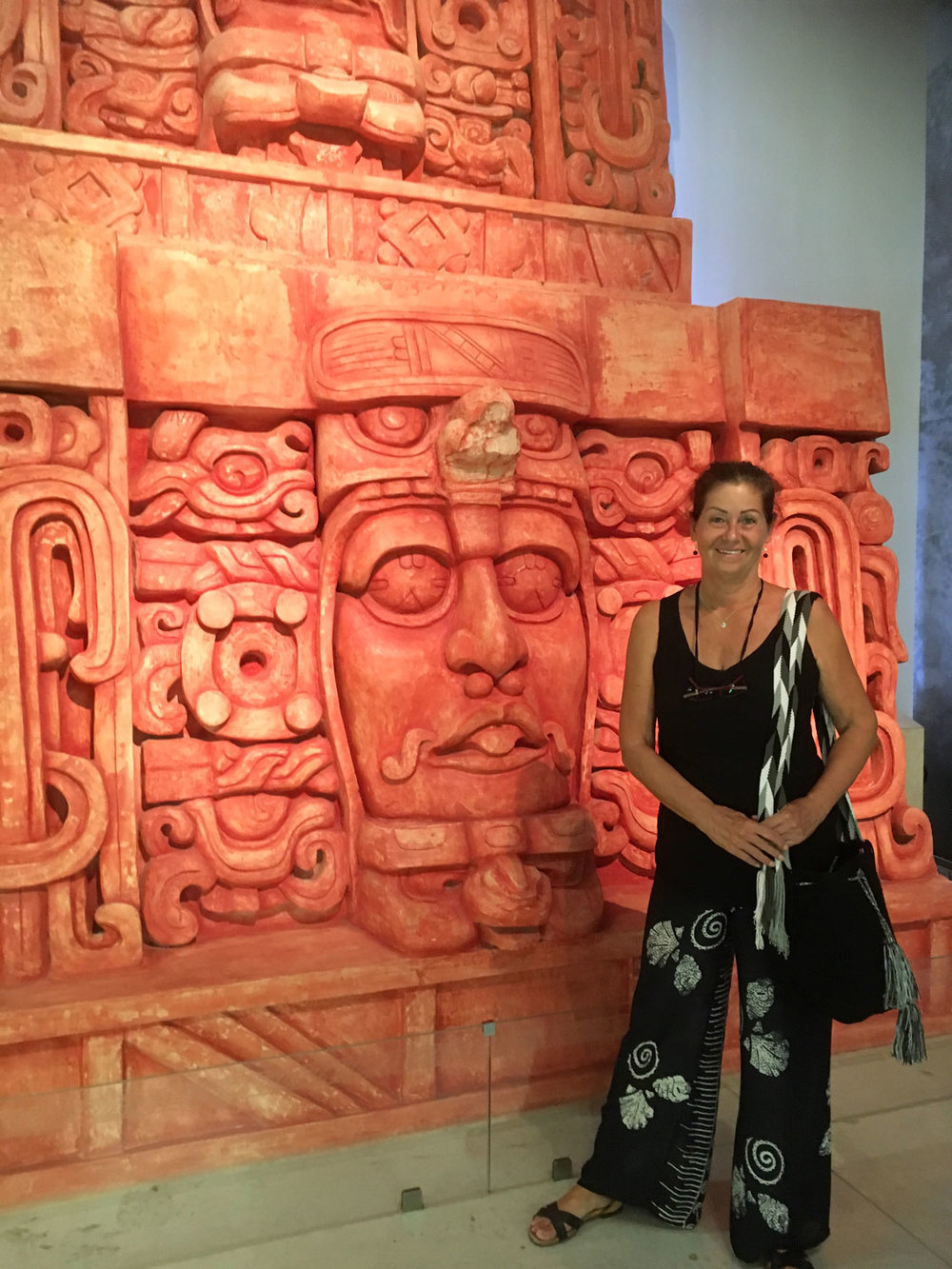 The Mayan World Museum really has the shape of the sacred tree. I am standing in front of the sculpture of the Kohunlich Sun God.