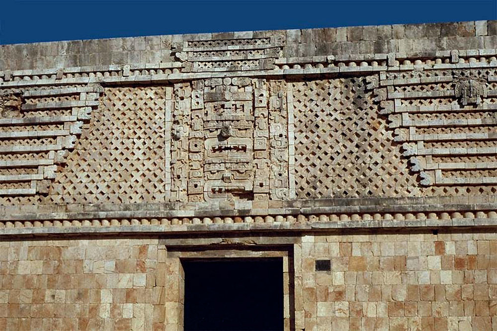 East building close up. Lattice pattern around the mask.