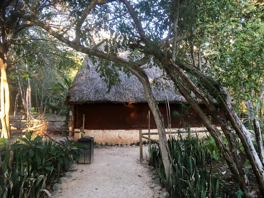A Maya hut as exhibition pavilion.