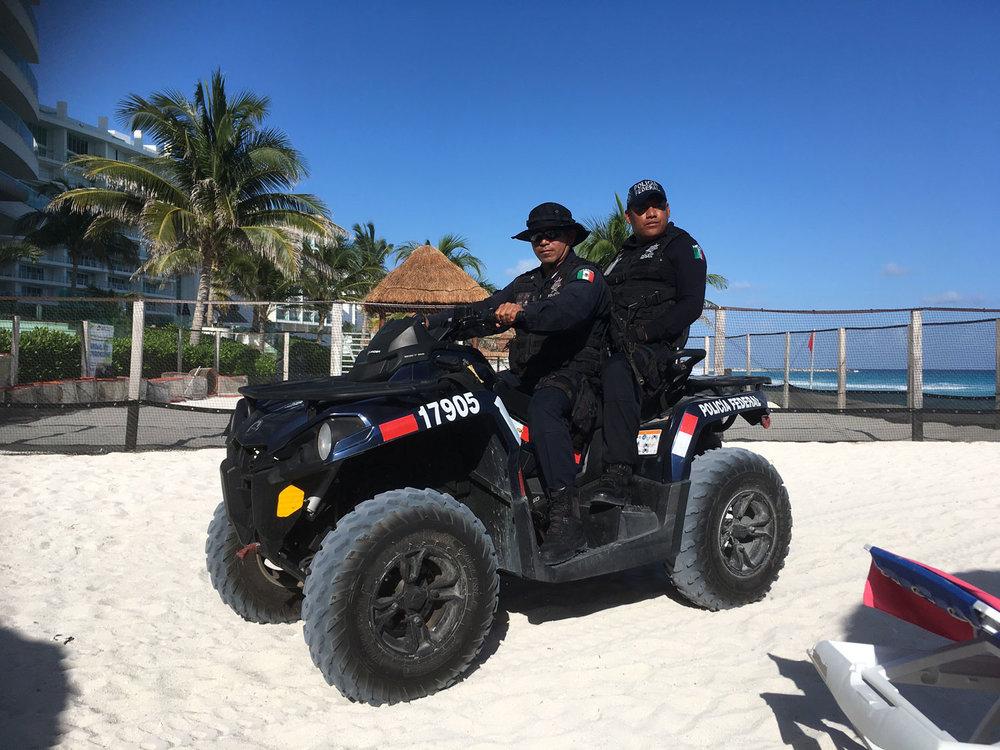 Police patrol on the beach.