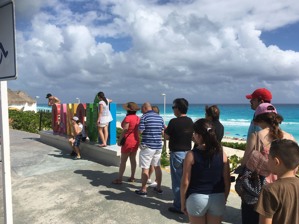 Crowds always wait for a photo opportunity with the Cancún letters.
