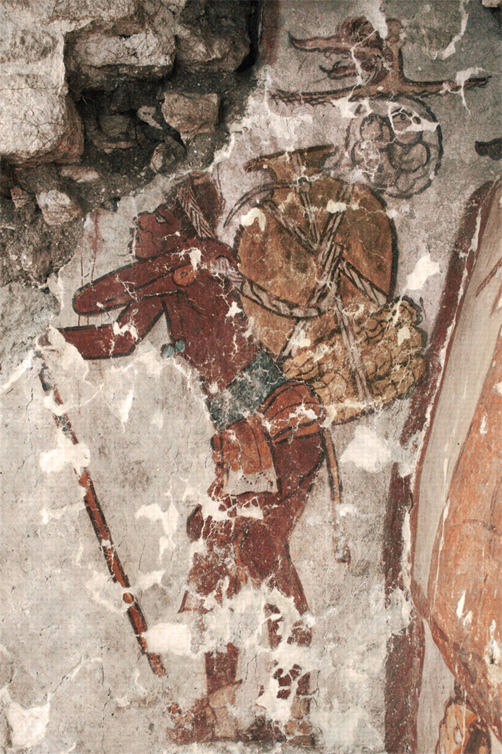 The slaves carried the products on their backs, fastened on the forehead. From a mural at Calakmul museum.