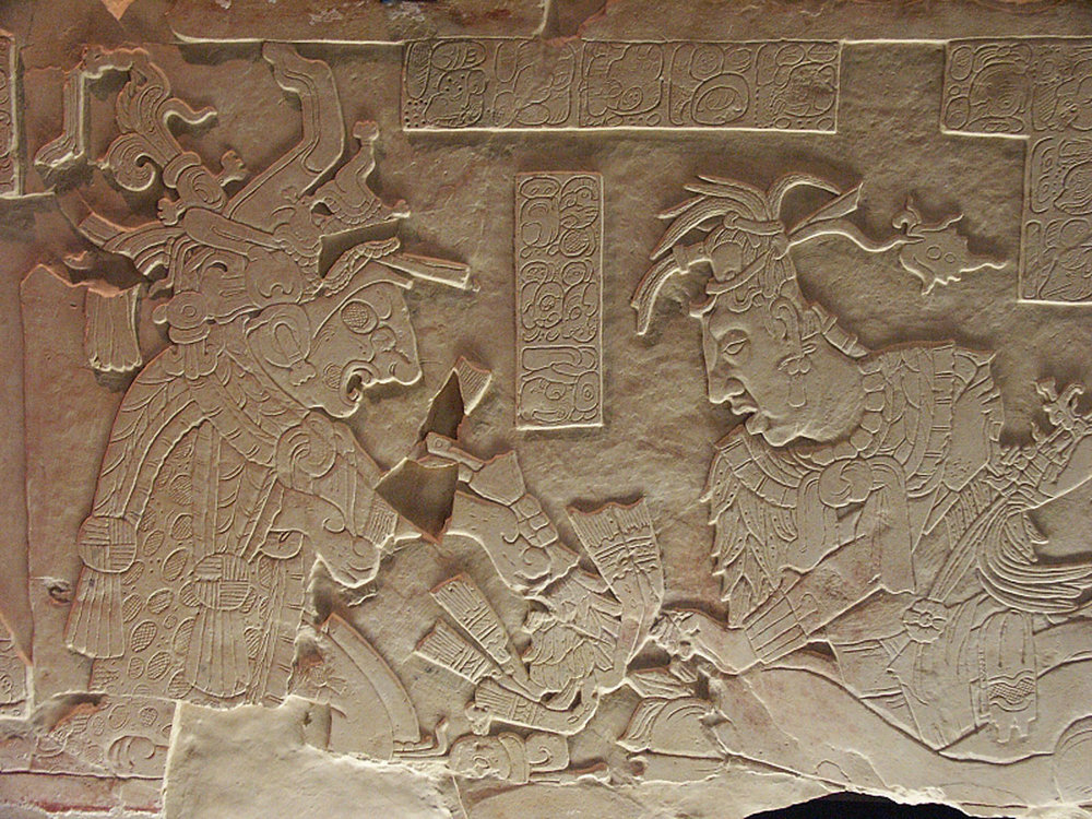 Ruler K'inich Ahkal Mo' Nahb (right) and the supernatural being (left). Source:  bluffton.edu  .  The same source is used in the photos below.