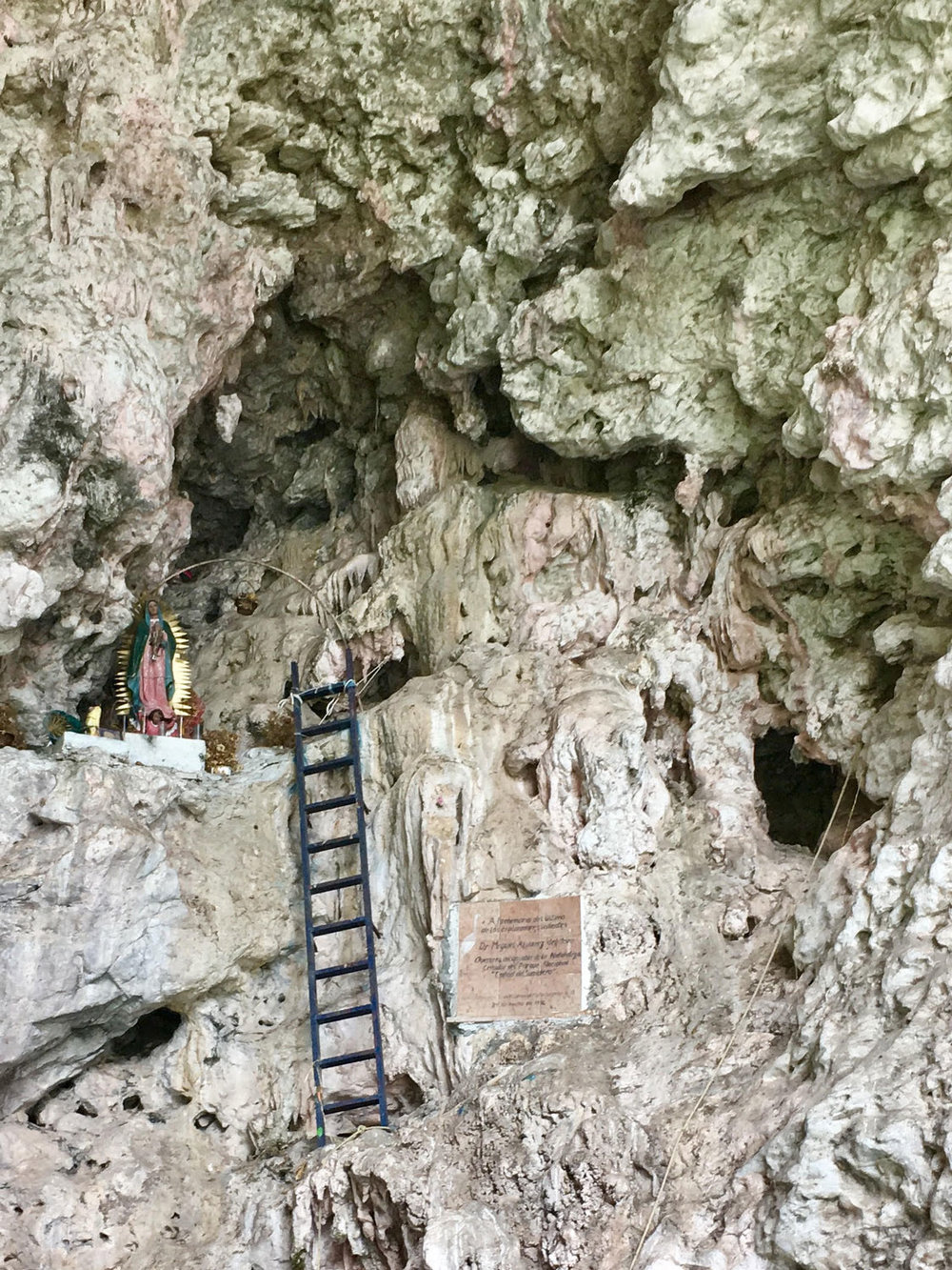 Cueva de Colores with Christ on cross. Left: the Christmas Tree