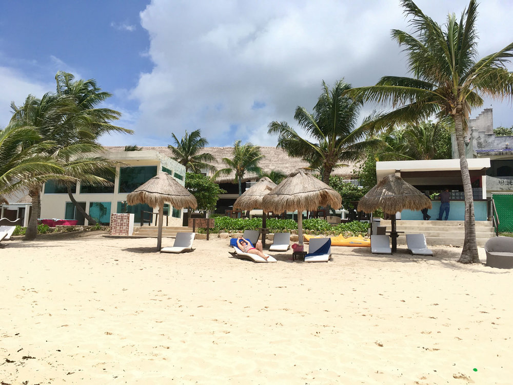 Cold coconuts, souvenirs and massage. Public beach.