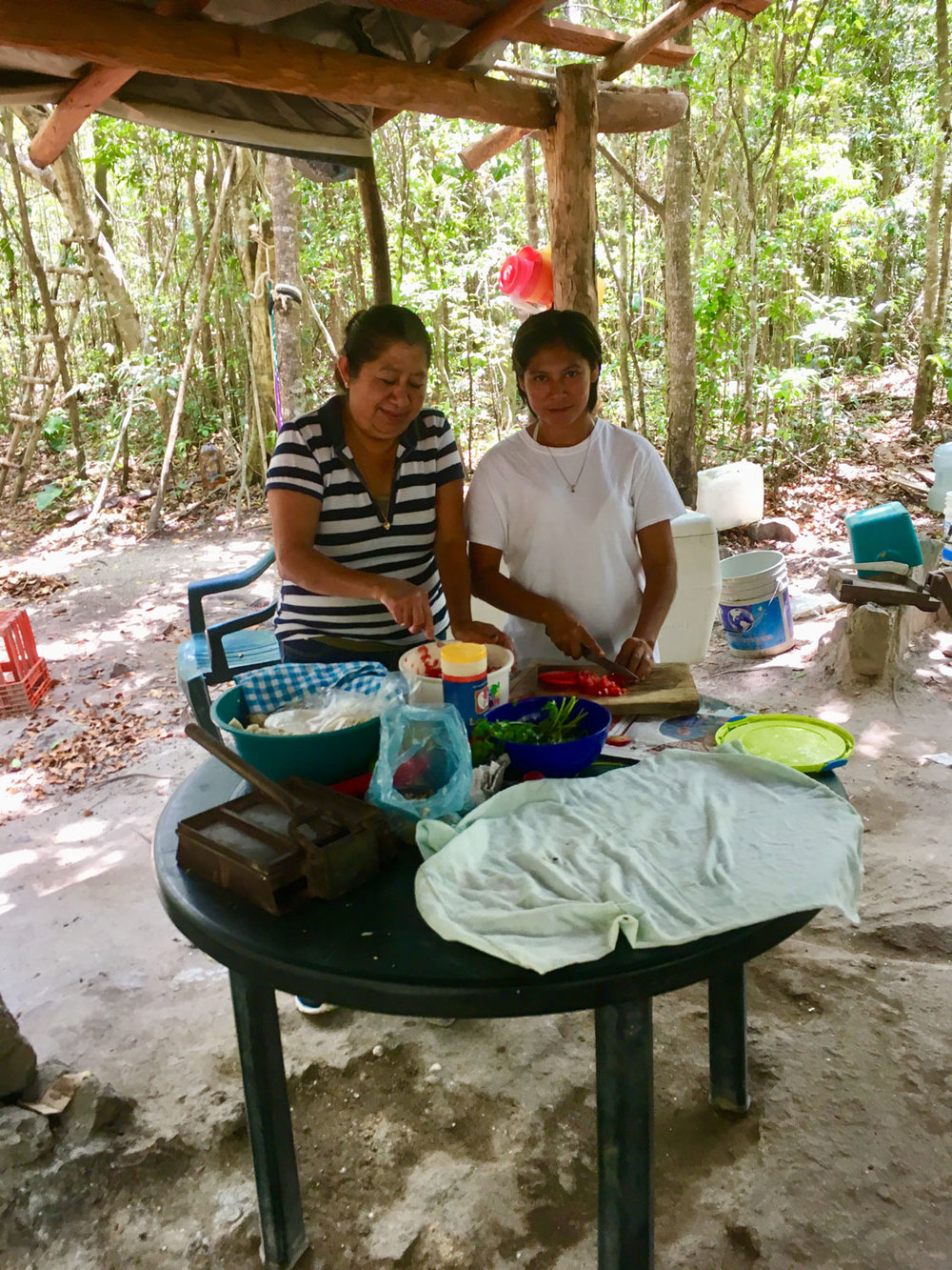 The local Maya women prepare the food in the rustic 'kitchen'.