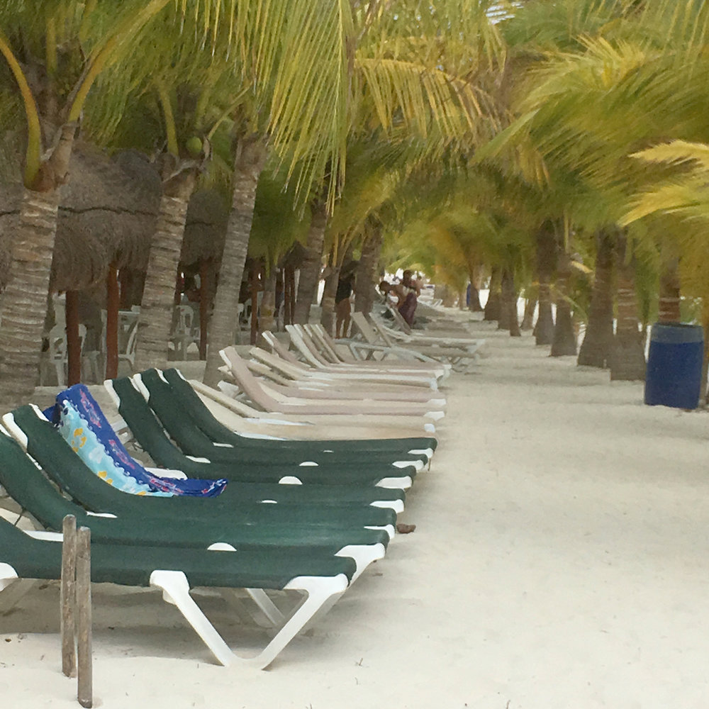 Plenty of deckchairs along the long beach.