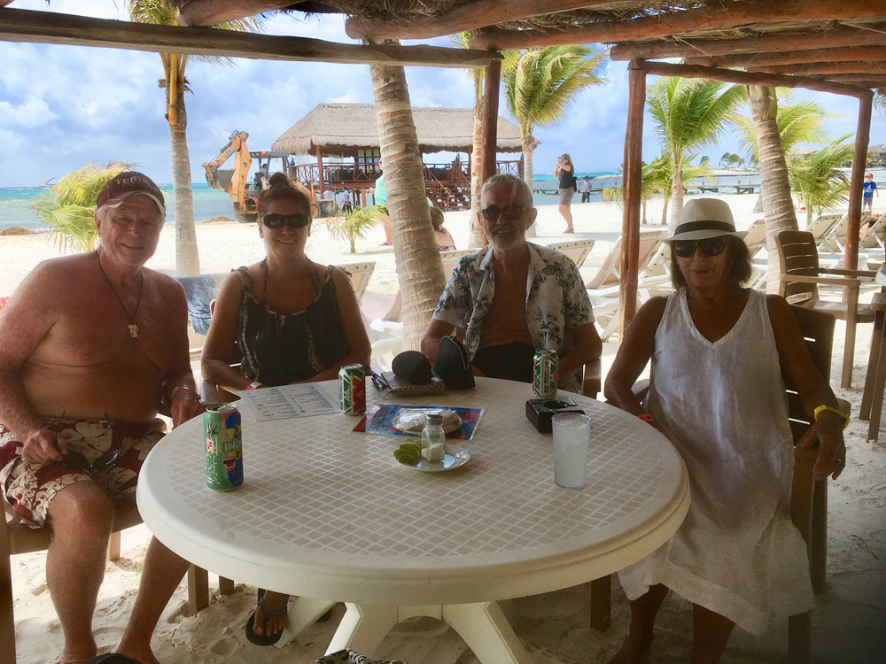 Under our palapa with Rhod and friends Michelle and Jim.