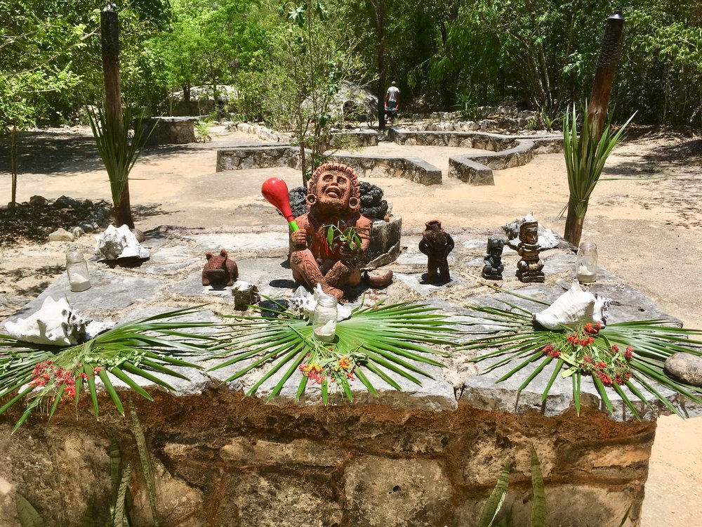 An altar in a Maya village outside Playa, used for cleansing rituals. Temazcal at the background.