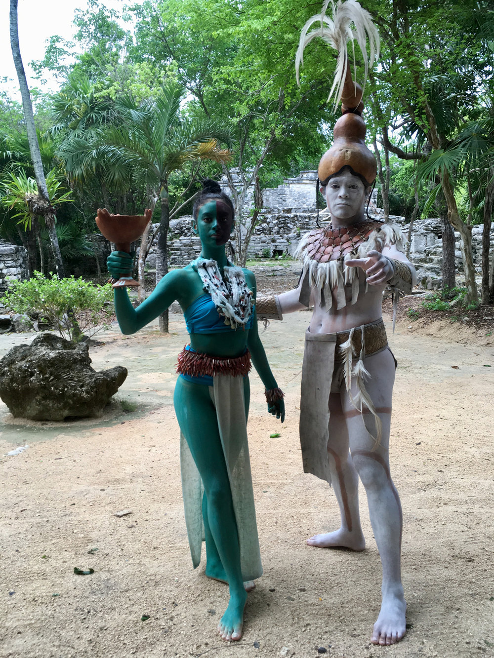 Priestess and priest outside the ruins during the annual sacred journey from Xcaret to Cozumel.