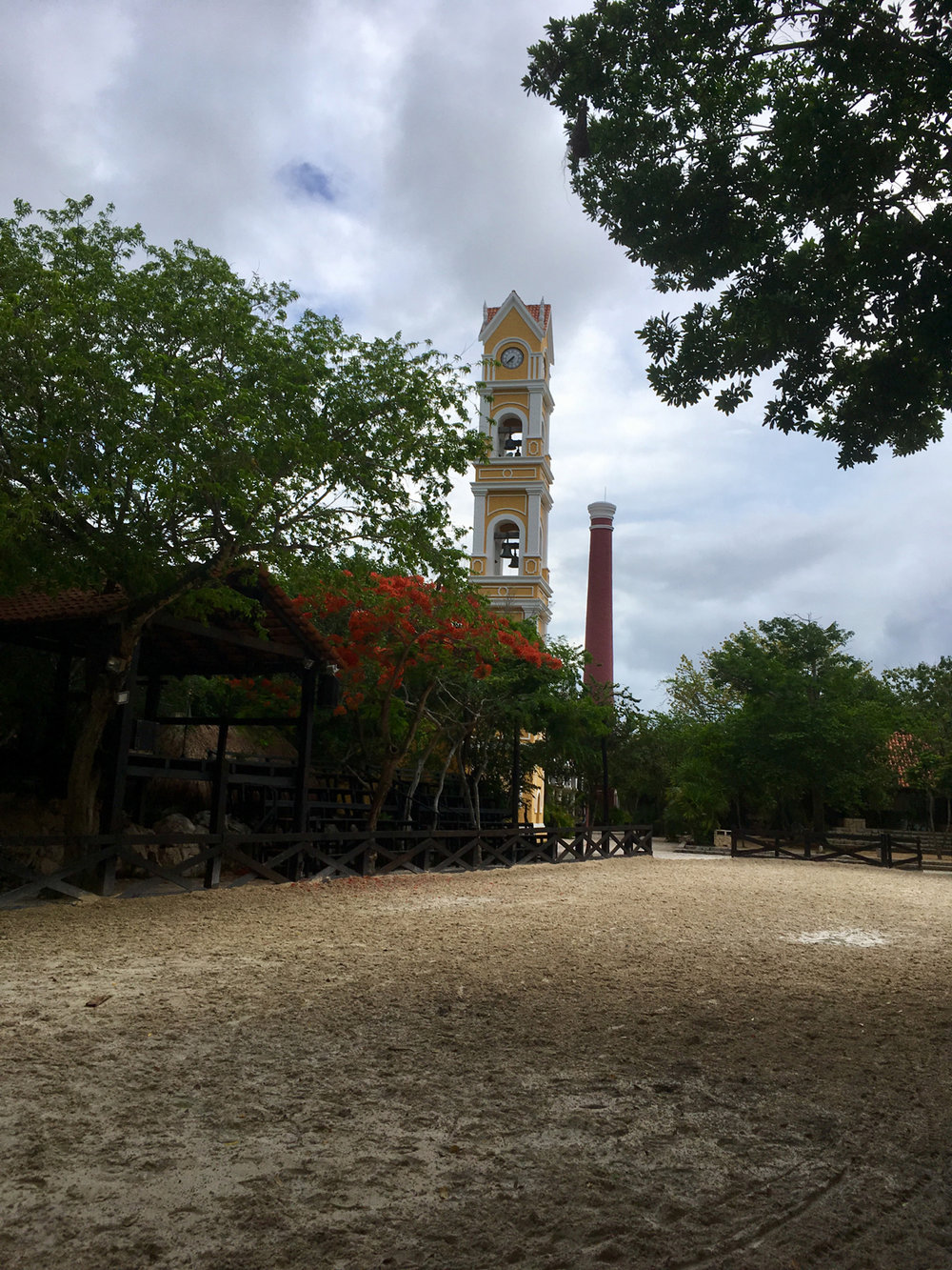 Xcaret hacienda with its chimney and the church.