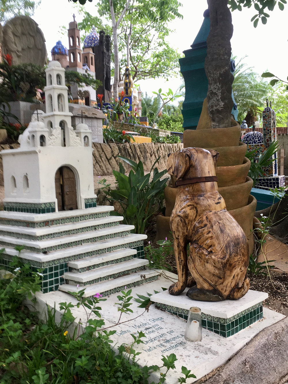 In ancient times, a dog was buried with his master. Today he has a sculpture at the cemetery instead.