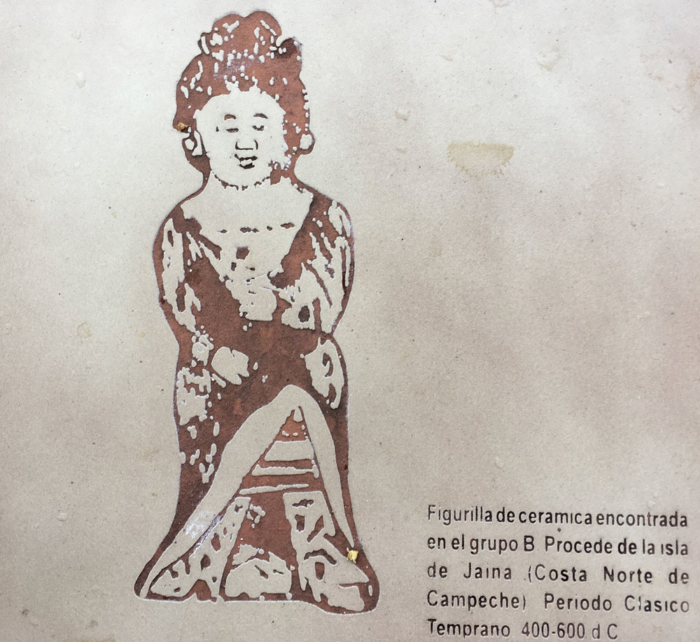 Ceramic figurine from Jaina island found in Group B (400-600 AD), as displayed by the  INAH  sign on the site.