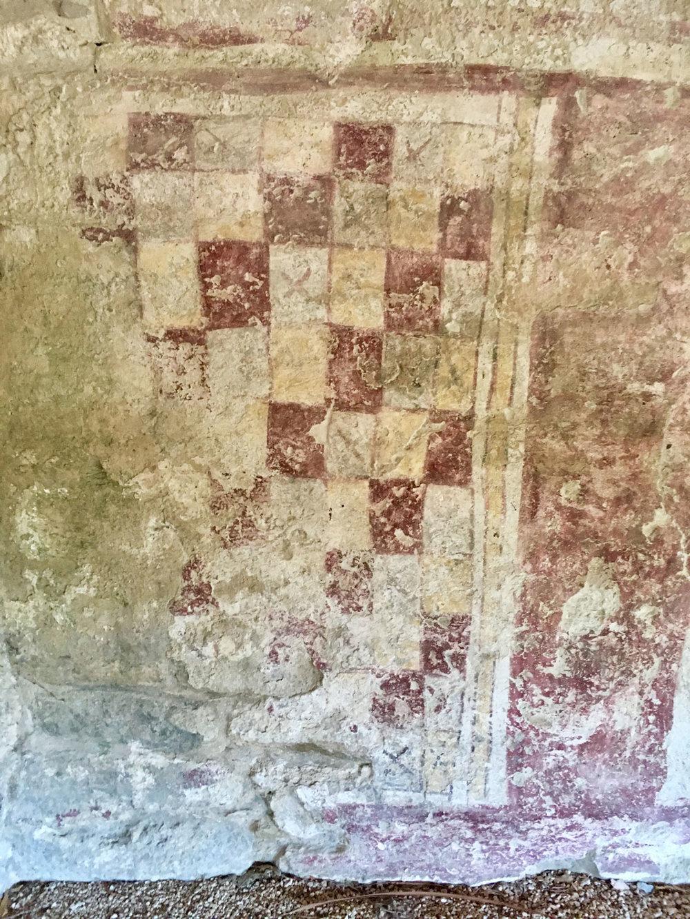 Mural 2: the checkerboard motif.