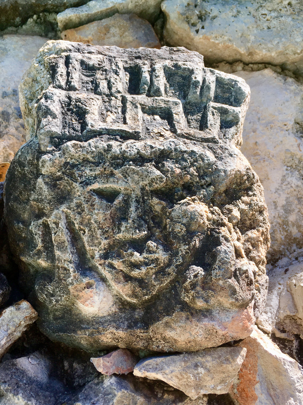 The ancient head sculpture by the pool, from Izamal ruins.