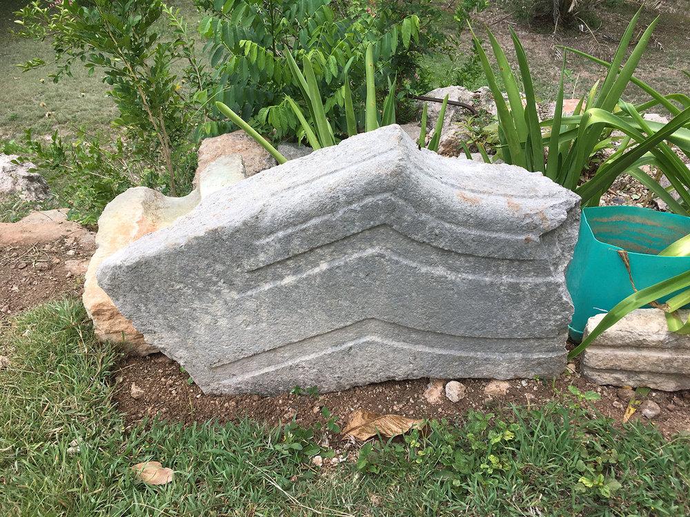 Ancient Maya friezes around the pool.