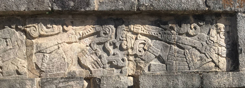 Reclining figure of a warrior with goggles (seen in the top right corner). The Platform of Eagles and Jaguars, Chichén Itzá.
