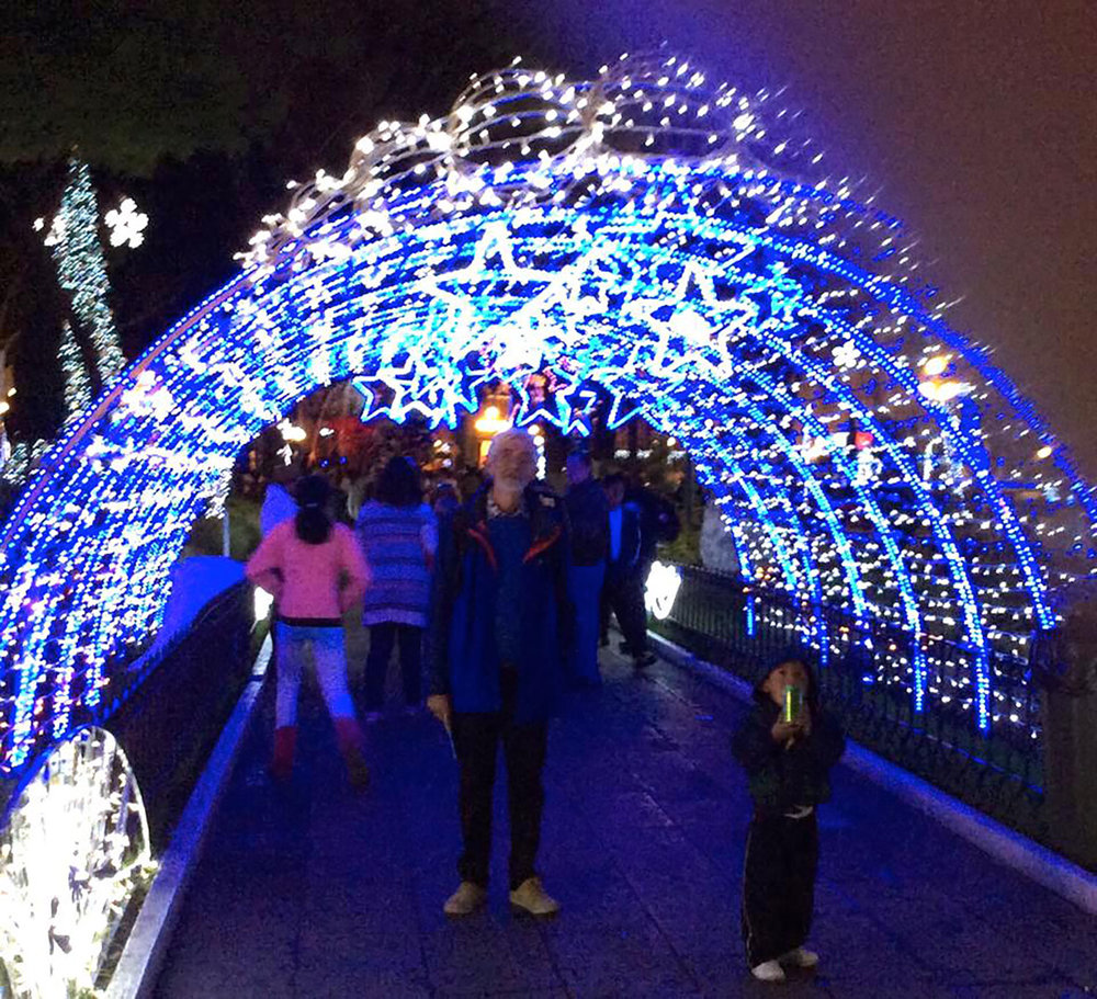 My husband Rhod lost amidst the Christmas lights in the park.