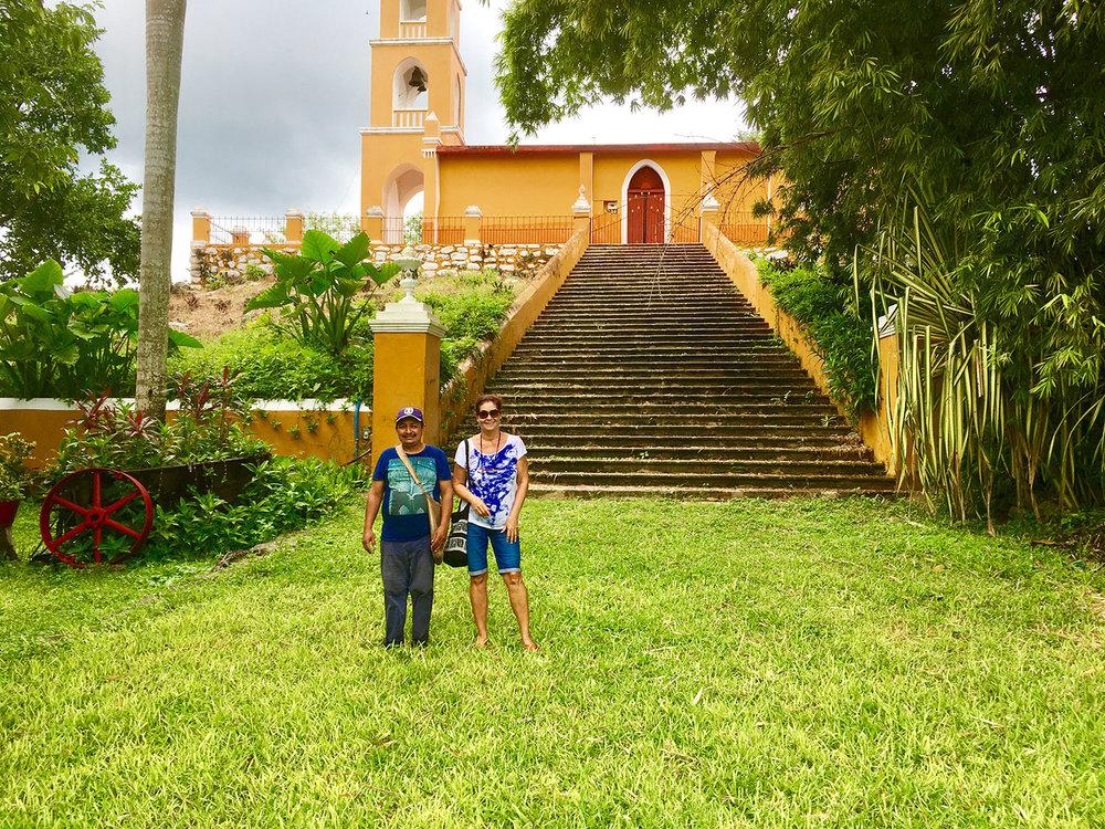 Outside the Aké hacienda chapel with our guide José.