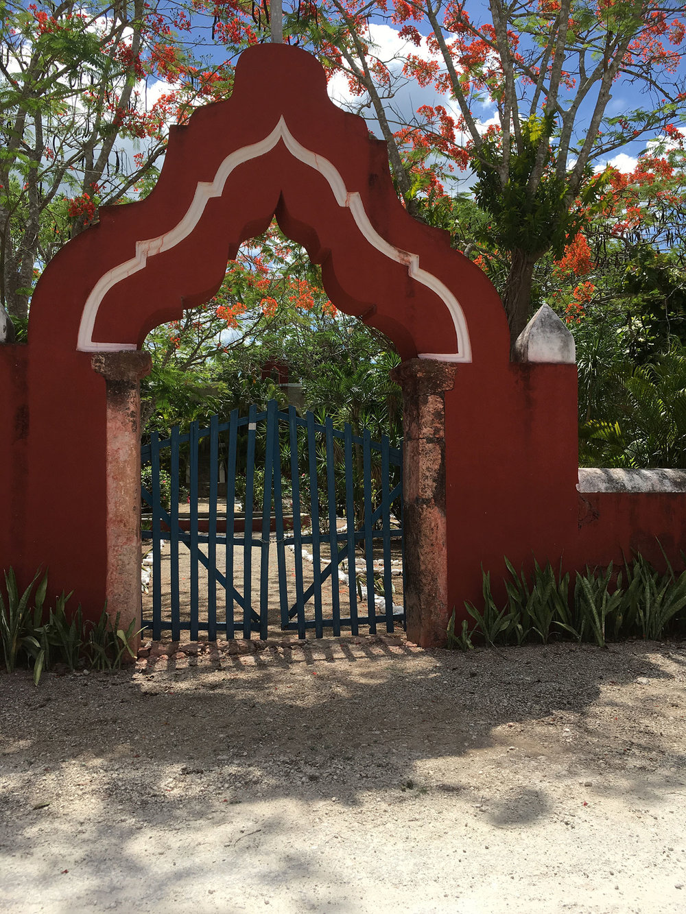Entrance gate to Hacienda San Antonio Dzina; and the well on the right.